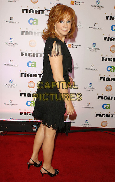 REBA McENTIRE.Muhammad Ali's Celebrity Fight Night XIV held at JW Marriott Desert Ridge Resort & Spa, Phoenix, Arizona, USA, 05 April 2008..full length black dress tassels back over shoulder fringed .CAP/ADM/MJT.©MJT/Admedia/Capital Pictures