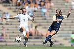 15 September 2013: Notre Dame's Sammy Scofield (11) shoots past North Carolina's Kealia Ohai (7). The University of North Carolina Tar Heels hosted the University of Notre Dame Fighting Irish at Fetzer Field in Chapel Hill, NC in a 2013 NCAA Division I Women's Soccer match. Notre Dame won the game 1-0.