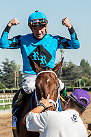 "ARCADIA, CA. OCTOBER 7: Kent Desormeaux flexes his muscles after riding #6 Roy H to a win in the Santa Anita Sprint Championship (Grade l)""Win and You're In Sprint Division"" on October 7, 2017, at Santa Anita Park in Arcadia, CA.(Photo by Casey Phillips/Eclipse Sportswire/Getty Images)"