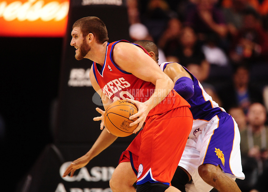 Dec. 28, 2011; Phoenix, AZ, USA; Philadelphia 76ers center Spencer Hawes during game against the Phoenix Suns at the US Airways Center. The 76ers defeated the Suns 103-83. Mandatory Credit: Mark J. Rebilas-USA TODAY Sports