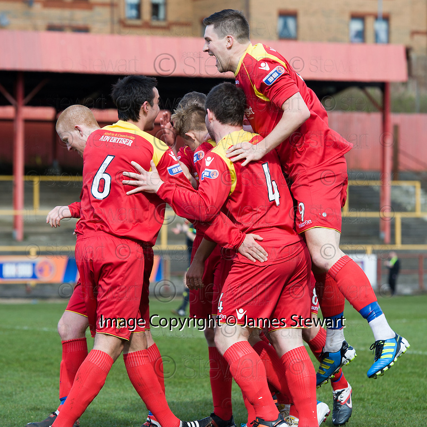 ALBION'S JACK WERNDLY IS CONGRATULATED  AFTER HE  SCORES THE FIRST