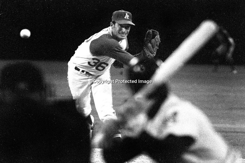 Oakland Athletics right hander Bob Locker delivers pitch ..(1970 photo/Ron Riesterer)
