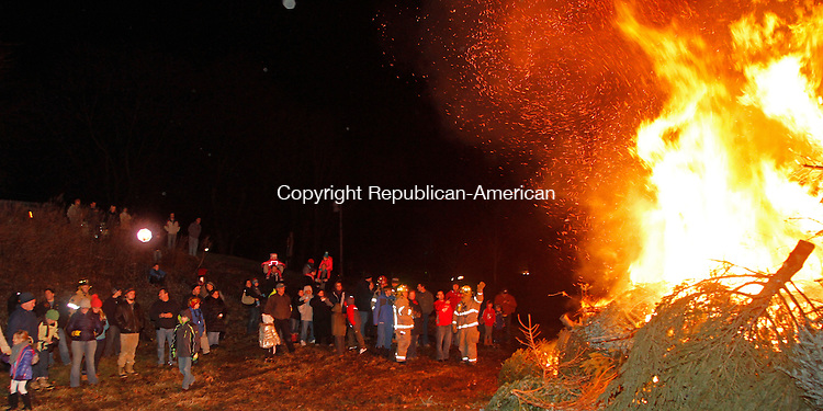 Woodbury, CT011814MK03  Over a hundred locals came to watch the trees burn during the Woodbury Volunteer Fire Department's annual Twelfth Night Christmas Tree Burn in Woodbury on Saturday evening.  Fire chief Morgan said that 300 trees had been collected for the burn which has been held annually for nearly twenty-five years.  Michael Kabelka Republican-American