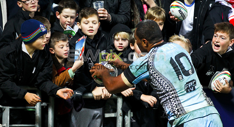 Picture by Alex Whitehead/SWpix.com - 09/11/2013 - Rugby League - Rugby League World Cup - England v Fiji - KC Stadium, Hull, England - Fiji's Petero Civoniceva signs autographs for fans.