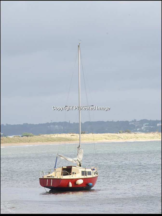 BNPS.co.uk (01202 558833)<br /> Pic: LauraJones/BNPS<br /> <br /> Aground and abandoned - Tim Freeman's boat on Studland beach in Dorset after his latest sailing fiasco.<br /> <br /> An incompetent sailor has been arrested by police after he sparked a 10th rescue operation in a month.<br /> <br /> Accident prone Tim Freeman, 24, was detained on land close to where he had ran his 24ft yacht aground at the beach at Studland, Dorset.<br /> <br /> Coastguards responded after a concerned member of the public reported seeing Mr Freeman stood in the surf struggling to control the vessel with a rope.<br /> <br /> By the time the emergency services arrived the Mr Freeman had left the area. He was found a short while later and arrested by police and taken into custody.<br /> <br /> It is hoped his detention will bring some respite to coastguard and lifeboat crews after Mr Freeman's calamitous solo voyages caused chaos at sea, costing them 20,000 pounds.<br /> <br /> Before the latest rescue effort last night (Thurs), the hapless mariner had triggered nine emergency call outs in a month for incidents ranging from running aground to getting lost.<br /> <br /> After he was rescued five times in a week by the RNLI off the Sussex coast, the Maritime and Coastguard Agency impounded his 21ft yacht for safety reasons.<br /> <br /> But Mr Freeman walked away from the 2,500 pounds vessel and simply went and bought a slightly bigger one called Reginald in Plymouth, Devon.<br /> <br /> After taking to sea again, the Sidmouth lifeboat was called out after he was seen attempting to run the yacht aground.<br /> <br /> He then sailed to Swanage, Dorset, where the local lifeboat was called out twice, once for drifting dangerously close to the shoreline and then after he fouled his propeller with a rope.<br /> <br /> Mr Freeman, from East Sussex, then ran the yacht aground again after getting lost and turning down a shallow channel in Poole Harbour.<br /> <br /> Despite coastguard appeals for 