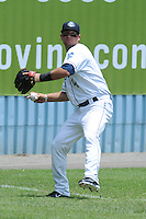 Asheville Tourists left fielder Avery Barnes #4 makes a throw during a game against the Augusta Green Jackets at McCormick Field on July 10, 2011 in Asheville, North Carolina.  Augusta won the game 10-2.   (Tony Farlow/Four Seam Images)