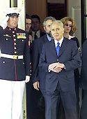 Foreign Minister Shimon Peres of Israel departs the White House to meet reporters following his meeting with United States President George W. Bush on May 3, 2001.<br /> Credit: Ron Sachs / CNP