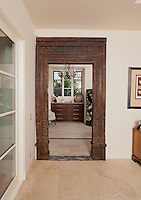 Old antique ethnic doorway leads to bedroom in modern home
