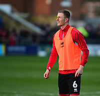 Lincoln City's Scott Wharton during the pre-match warm-up<br /> <br /> Photographer Andrew Vaughan/CameraSport<br /> <br /> The EFL Sky Bet League Two - Lincoln City v Port Vale - Tuesday 1st January 2019 - Sincil Bank - Lincoln<br /> <br /> World Copyright © 2019 CameraSport. All rights reserved. 43 Linden Ave. Countesthorpe. Leicester. England. LE8 5PG - Tel: +44 (0) 116 277 4147 - admin@camerasport.com - www.camerasport.com