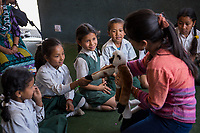 Nepal, Kathmandu. Clark Memorial School. Counselor from Ankur counseling and training helping children and their teachers deal with ongoing trauma from the earthquake. Children learning to express through friendly puppets.