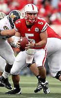 Nebraska quarterback Zac Lee (5) looks to complete a handoff during the second half. No. 14 Nebraska beat  No. 7 Missouri 31-17 at Memorial Stadium in Lincoln, Nebraska.