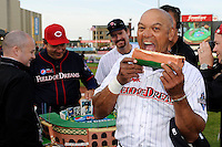 Hall of Fame outfielder Reggie Jackson #44 takes a big bite from his birthday cake presented to him by Johnny Bench during the MLB Pepsi Max Field of Dreams game as Wade Boggs #12 looks on on May 18, 2013 at Frontier Field in Rochester, New York.  (Mike Janes/Four Seam Images)