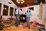 Rosaleen and her husband Rob,play with their son Sean before she must leave again for the WTC site..A day in the life of Rosaleen Tallon, sister of firefighter Sean Tallon killed in the 9/11 World Trade Center attacks. In response to the proposed WTC memorial being built underground at the site, Ms. Tallon has been sleeping for 16 days in front of the fire house across from the WTC site. She and several other WTC families are protesting the memorial design and asking for the victim's names to be placed above ground for the sake of honoring the lives lost and safety concerns with any possible future evacuation of the site.