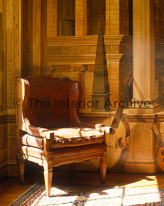 The trompe l'oeil wall, by Renzo Mondiardino, gives the illusion that a Renaissance musician recently sat strumming in the sunlit armchair