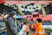 Steward talks to a fan <br /> Re: Behind the Scenes Photographs at the Liberty Stadium ahead of and during the Premier League match between Swansea City and Bournemouth at the Liberty Stadium, Swansea, Wales, UK. Saturday 25 November 2017