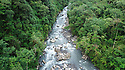 Aerial view of small river and mid-altitude montane rainforest. Manu Biosphere Reserve, Amazonia, Peru.