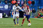 Atletico de Madrid´s Filipe Luis (R) and Real Sociedad´s Carlos Vela during 2015-16 La Liga match between Atletico de Madrid and Real Sociedad at Vicente Calderon stadium in Madrid, Spain. March 01, 2016. (ALTERPHOTOS/Victor Blanco)