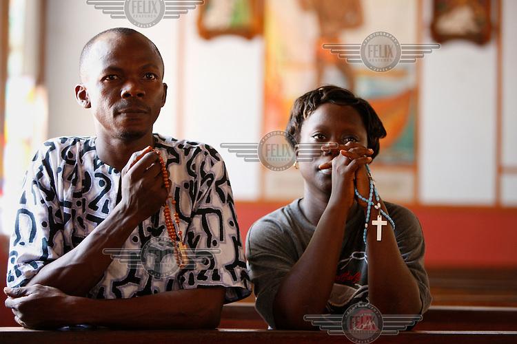 A couple pray in church.