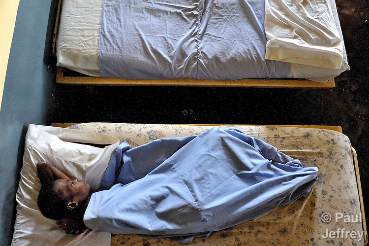 """A patient at the """"House for the Dying"""", a hospice for AIDS patients and other terminally ill patients run by the Sisters of Charity in Port au Prince, Haiti."""