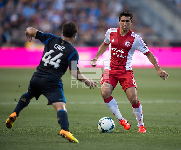 Danny Cruz (44) of the Philadelphia Union tries to take the ball away from Diego Valeri (8) of the Portland Timbers during a Major League Soccer game at PPL Park in Chester, PA.  Philadelphia Union tied the Portland Timbers, 0-0.