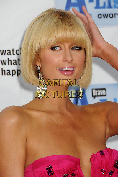"PARIS HILTON.Bravo's 2nd Annual ""The A-List Awards"" held at The Orpheum Theatre, Los Angeles, CA, USA..April 5th, 2009.headshot portrait strapless dangling silver earrings pink hand diamante.CAP/ADM/BP.©Byron Purvis/AdMedia/Capital Pictures."