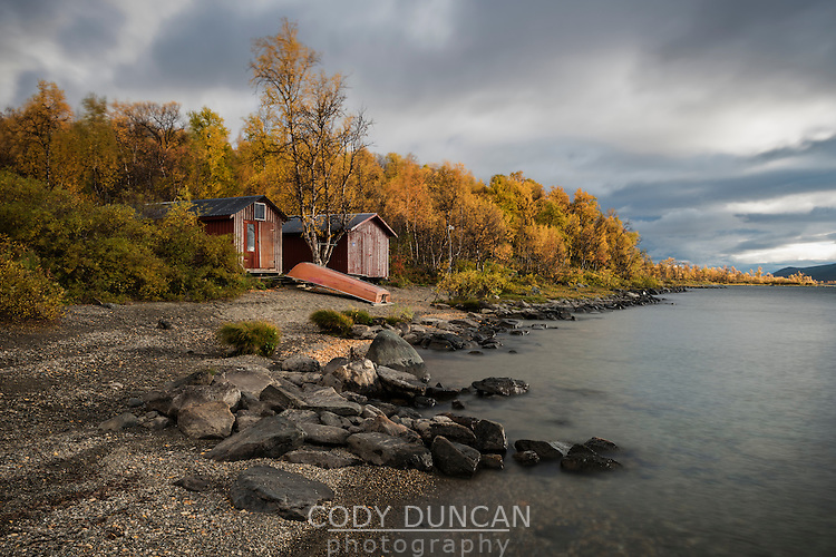 boat sheds on shore of lake Tärnasjön, Kungsleden trail, Lapland, Sweden