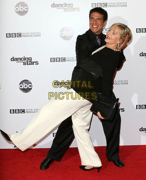 CORKY BALLAS & FLORENCE HENDERSON.'Dancing With The Stars' 200th Episode held at Boulevard 3, Hollywood, CA, USA..November 1st, 2010.full length suit jacket black white flared profile eyes closed trousers dance gesture side bending dip.CAP/ADM/FS.©Faye Sadou/AdMedia/Capital Pictures.