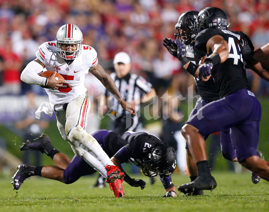 Ohio State Buckeyes quarterback Braxton Miller (5) dodges a tackle by Northwestern Wildcats cornerback Nick VanHoose (23) during Saturday's NCAA Division I football game at Ryan Field in Evanston on October 5 2013. (Barbara J. Perenic/The Columbus Dispatch)