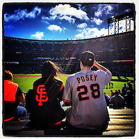 SAN FRANCISCO, CA - JULY 9: Instagram of fans of Buster Posey and the San Francisco Giants sitting in the bleachers before a game against the Oakland Athletics at AT&T Park on July 9, 2014 in San Francisco, California. Photo by Brad Mangin