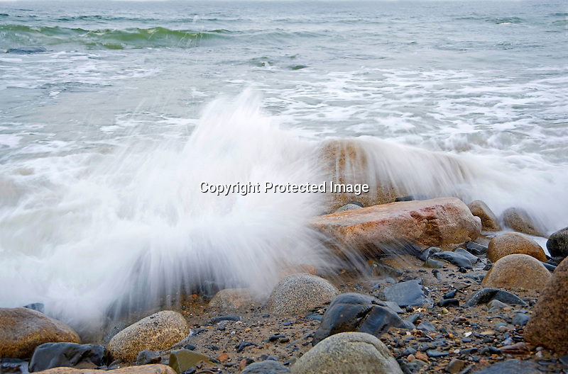 Ocean Surf Crashing against Shore Rocks during Incoming Tide on the Coast of Maine