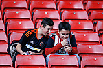 Fans look at their phones during the Carabao Cup, second round match at Bramall Lane, Sheffield. Picture date 22nd August 2017. Picture credit should read: Simon Bellis/Sportimage