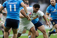 Billy Vunipola of England forces his way through a tackle during the RBS 6 Nations match between England and Italy at Twickenham Stadium on Saturday 14th February 2015 (Photo by Rob Munro)
