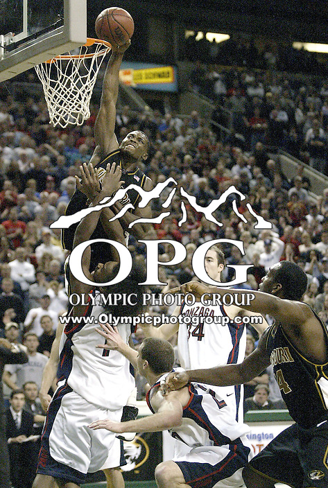 December 15, 2003:  Missouri Tigers Rickey Paulding tried to land a monster dunk in the second half but hit the rim as Ronny Turiaf of Gonzaga came crashing in. Gonzaga won the annual Battle in Seattle 87-80 held at Key Arena at Key Arena in Seattle, WA.