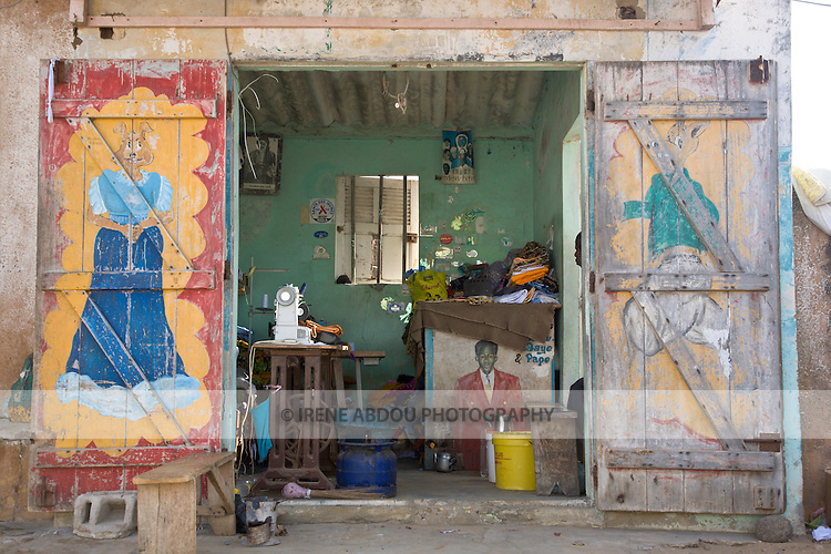 With Senegal's adult literacy rate at only 39%, many shops, like this tailor in Yoff, a fishing village 30 minutes from Dakar, display pictures of their services.