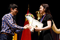 Se Hee Hwang from South Korea receives the Hong Kong Harp Centre Prize (fourth prize) during the awards ceremony of the 11th USA International Harp Competition at Indiana University in Bloomington, Indiana on Saturday, July 13, 2019. (Photo by James Brosher)