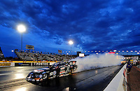 Nov. 1, 2008; Las Vegas, NV, USA: NHRA funny car driver John Force does a burnout during qualifying for the Las Vegas Nationals at The Strip in Las Vegas. Mandatory Credit: Mark J. Rebilas-