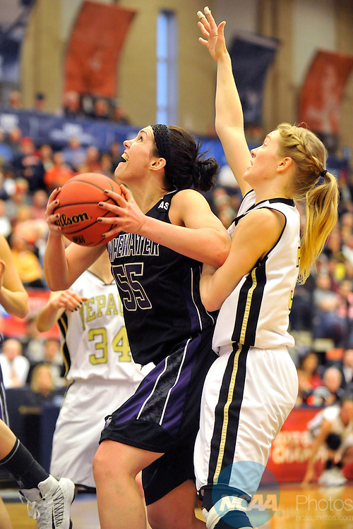 16 MAR 2013:  Cortney Kumerow (55) of the University of Wisconsin-Whitewater drives past Erin Mcginnis (35) of DePauw University during the Division III Women's Basketball Championship held at the DeVos Fieldhouse in Holland, MI.  DePauw defeated Whitewater 69-51 for the national title.  Erik Holladay/NCAA Photos..