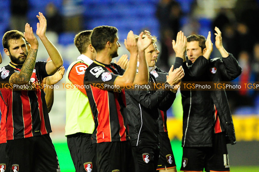 AFC Bournemouth Manager Eddie Howe middle joins in the applause for the travelling AFC Bournemouth supporters - Reading vs AFC Bournemouth - Sky Bet Championship Football at the Madejski Stadium, Reading, Berkshire - 14/04/15 - MANDATORY CREDIT: Denis Murphy/TGSPHOTO - Self billing applies where appropriate - contact@tgsphoto.co.uk - NO UNPAID USE