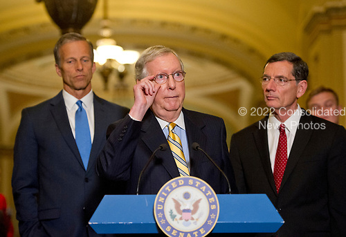 United States Senate Majority Leader Mitch McConnell (Republican of Kentucky) speaks to reporters following the Republican Party luncheon in the United States Capitol in Washington, DC on Tuesday, June 27, 2017.  In his remarks, Leader McConnell announced there would be no vote on the GOP healthcare plan this week. From left to right: US Senator John Barrasso (Republican of Wyoming), Leader McConnell, and US Senator John Thune (Republican of South Dakota).<br /> Credit: Ron Sachs / CNP