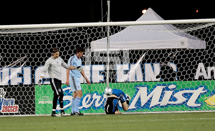 Cam Weaver (17) rolls over after scoring in the 8th minute against Preston Burpo (45). San Jose Earthquakes defeated the Colorado Rapids 2-0 at Buck Shaw Stadium in Santa Clara, California on February 27th, 2009. Photo by Kelley Cox /isiphotos.com