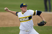 Michigan Wolverines pitcher Jake Balicki (36) delivers a pitch to the plate during the NCAA baseball game against the Washington Huskies on February 16, 2014 at Bobcat Ballpark in San Marcos, Texas. The game went eight innings, before travel curfew ended the contest in a 7-7 tie. (Andrew Woolley/Four Seam Images)