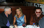 WEST HOLLYWOOD, CA. - February 08: Musicians Adam Clayton of U2, Sheryl Crow and Bono of U2 attend the Universal Music Group Chairman Doug Morris' Grammy Awards Viewing Dinner at The Palm on February 8, 2009 in West Hollywood, California.