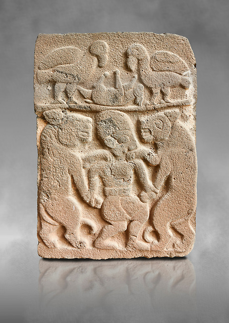Pictures & images of the North Gate Hittite sculpture stele depicting man with wolves. 8the century BC.  Karatepe Aslantas Open-Air Museum (Karatepe-Aslantaş Açık Hava Müzesi), Osmaniye Province, Turkey. Against grey art background