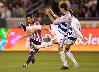 Chivas USA midfielder Paulo Nagamura takes a shot on goal past FC Dallas defender Marcelo Saragosa. The Chivas USA defeated FC Dallas 2-0 at Home Depot Center stadium in Carson, California on Saturday April 25, 2009.   .