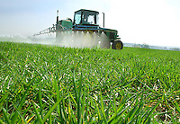 Roger Pearce applying manganese and general weedkiller to 40 hectares of Carat winter barley on F. A. Jones'  Wheatley Farm, Astley, Shrewsbury, Shropshire.