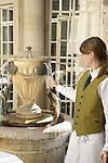 Waiteress serving mineral water, Pump Room Tea Room, Bath, England, UK