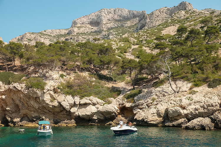 Sun seeking boaters are drawn to the picturesque coves along the Les Calanques coastline.