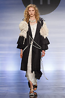 Model walks runway in an outfit by Natasha Pineiro, during the Future of Fashion 2017 runway show at the Fashion Institute of Technology on May 8, 2017.