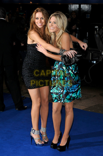 "UNA HEALY & MOLLIE KING of The Saturdays .Arrivals - World Premiere of ""Avatar"",  Odeon Leicester Square, London, England, UK, December 10th, 2009..full length black dress Strapless hugging clutch bag shoes blue green print platform silver ankle strap buckle .CAP/PL.©Phil Loftus/Capital Pictures."