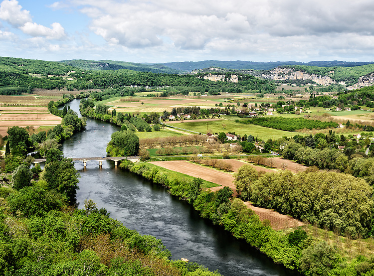 View of the Dordogne River and surrounding landscape, as seen from the ramparts of the village of Domme.